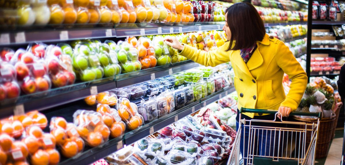 Young Chinese woman shopping for fruit