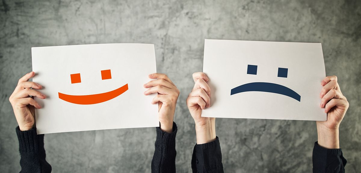 Happy and sad face emoticons