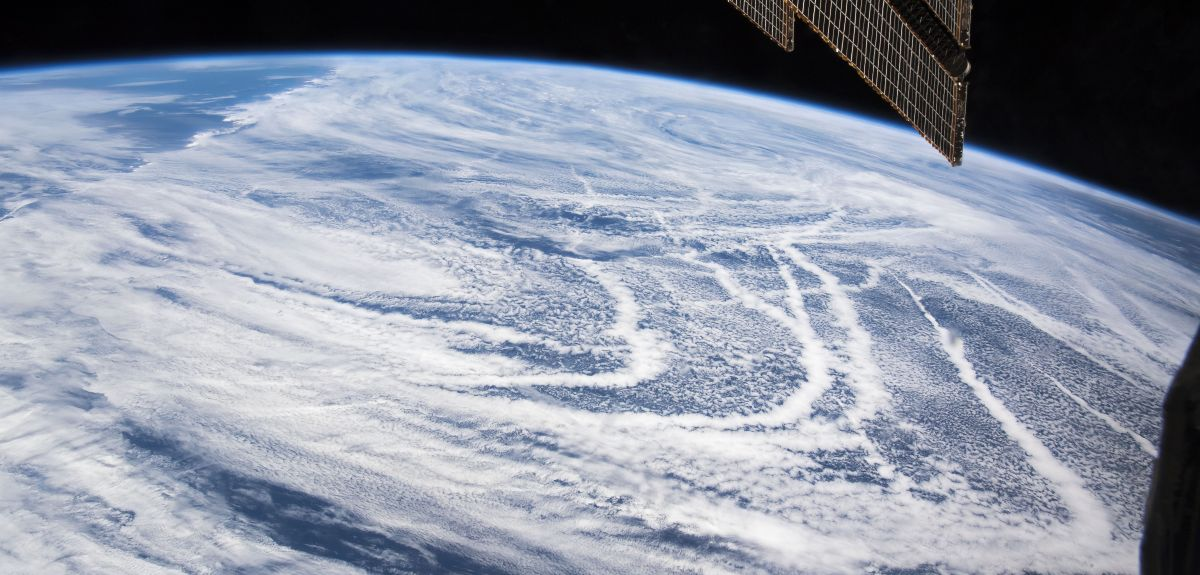 Exhaust creates cloud lines that trace the curved trajectories of ships