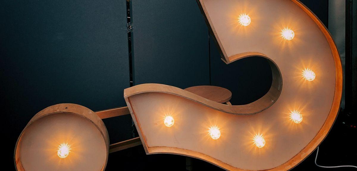 Light box question mark symbol. Image by Jon Tyson on Unsplash.