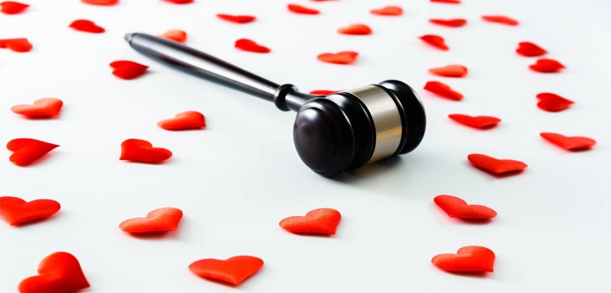 A gavel on a background of hearts