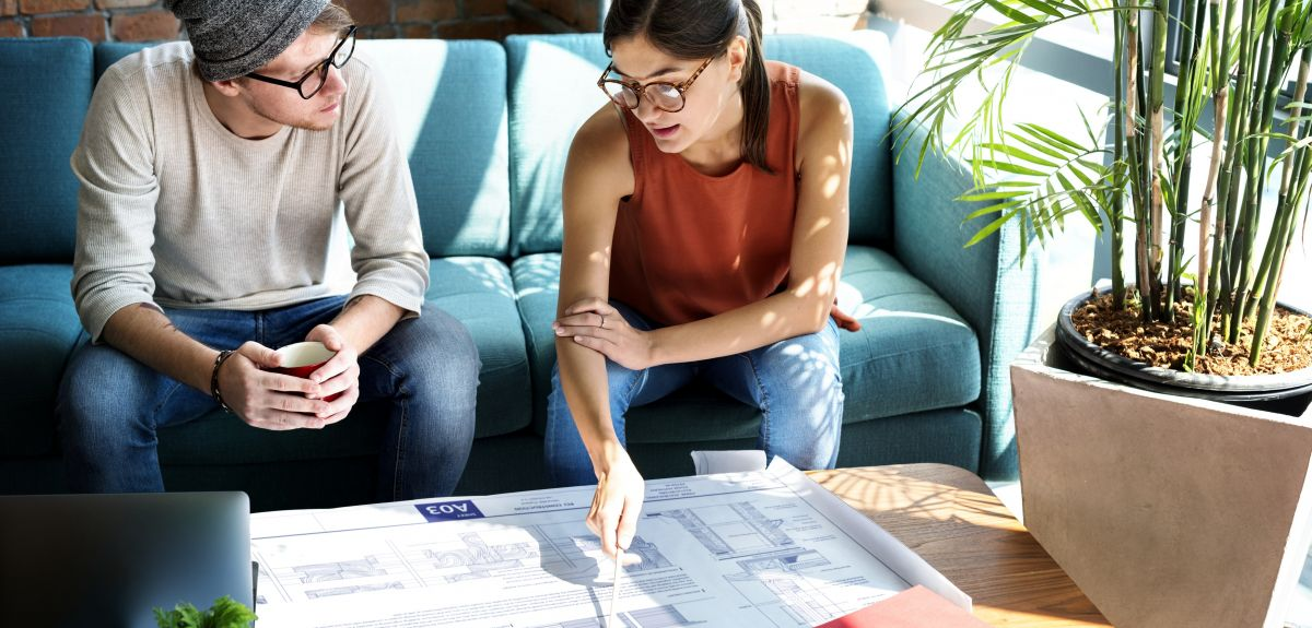 Woman and man reviewing blueprints