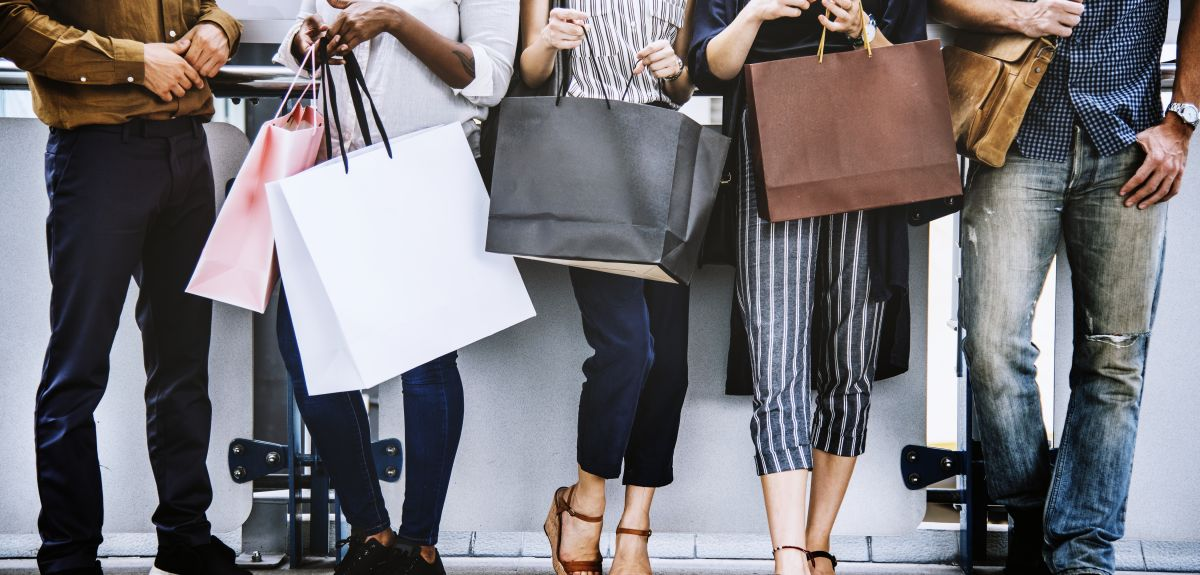Five students with shopping bags