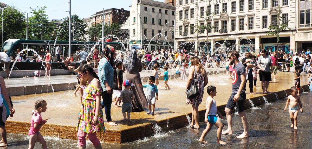 People in fountain in Nottingham, UK