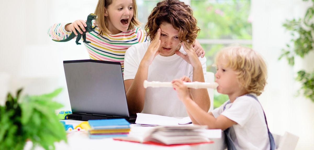 Working mother struggling to work with children at home