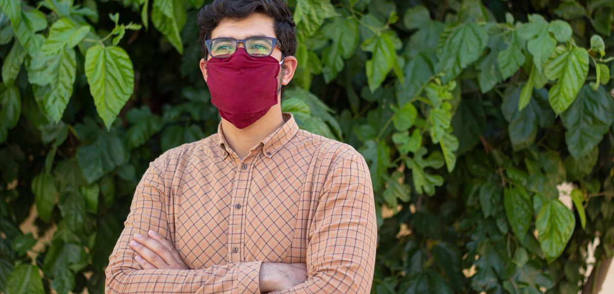 Man wears a cloth face mask