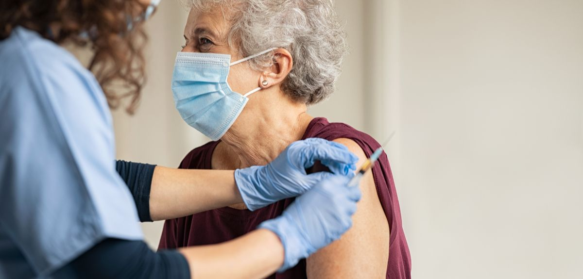 Photo | Elderly woman receiving a vaccination
