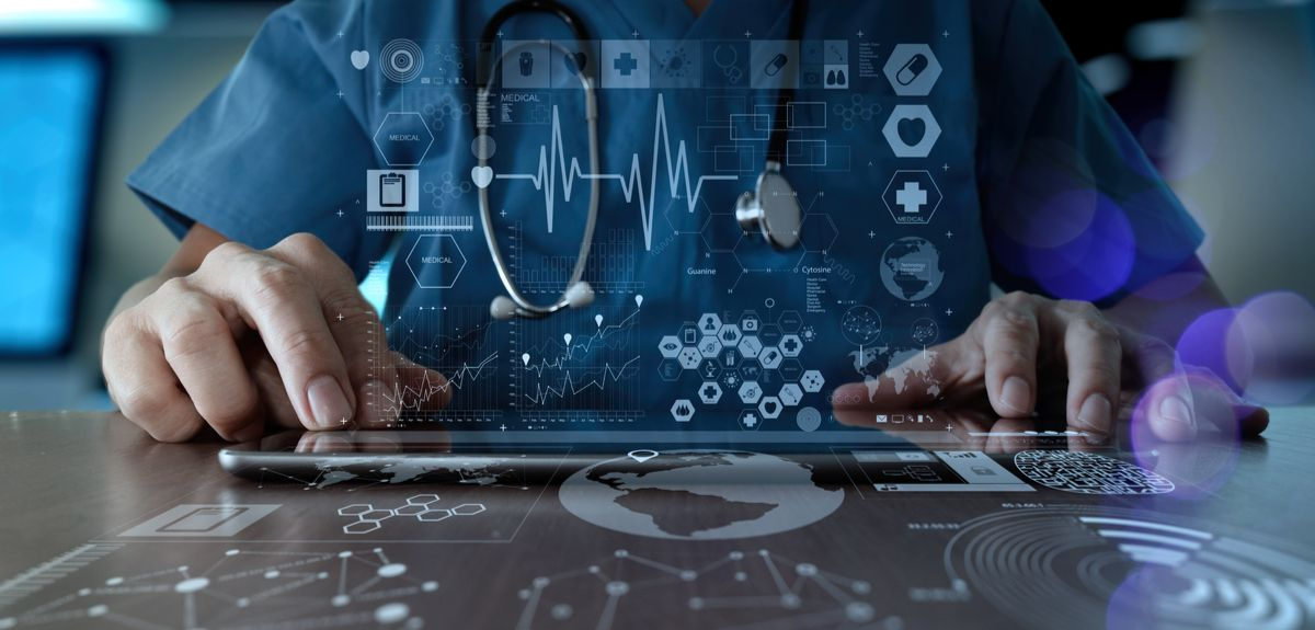 Doctor looking at touch screen of data