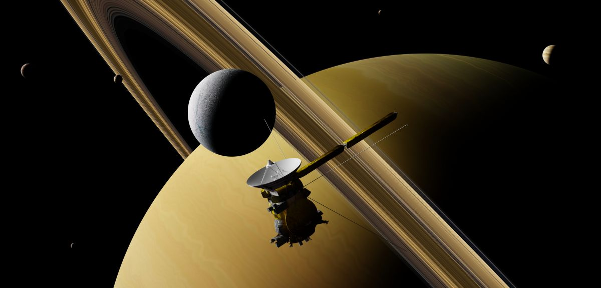 Saturn's moon Enceladus and spacecraft Cassini–Huygens in front of planet Saturn, rings and other moons (3D illustration, elements of this image are furnished by NASA)
