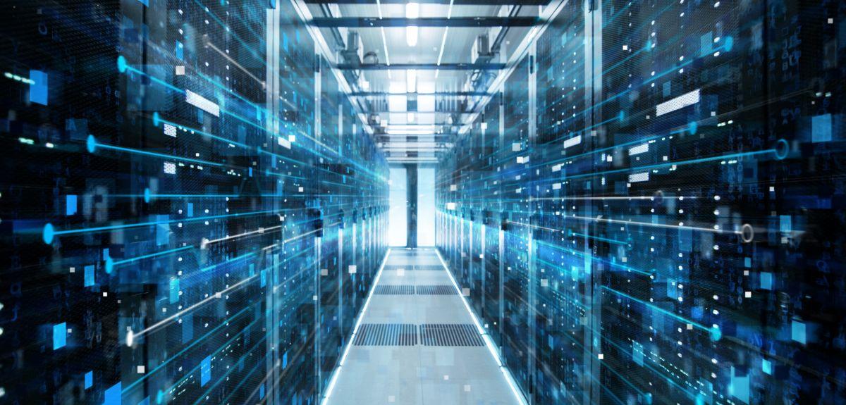 Shot of Corridor in Working Data Center Full of Rack Servers and Supercomputers