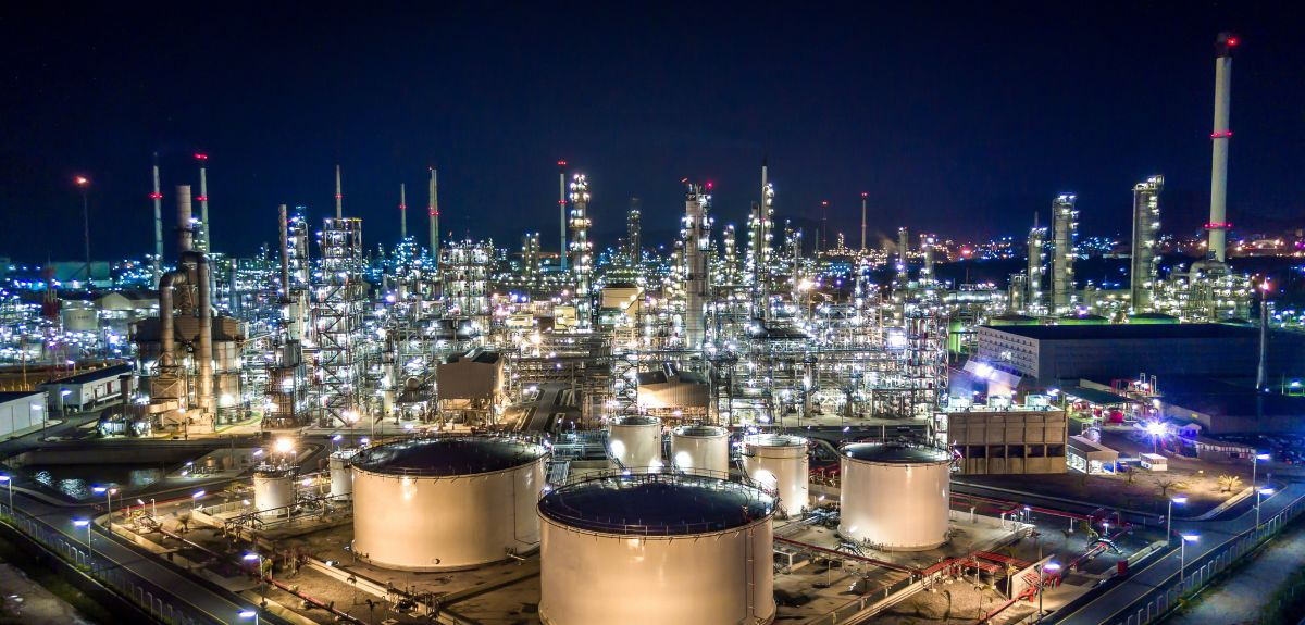 Aerial view oil and gas tank with oil refinery background at night