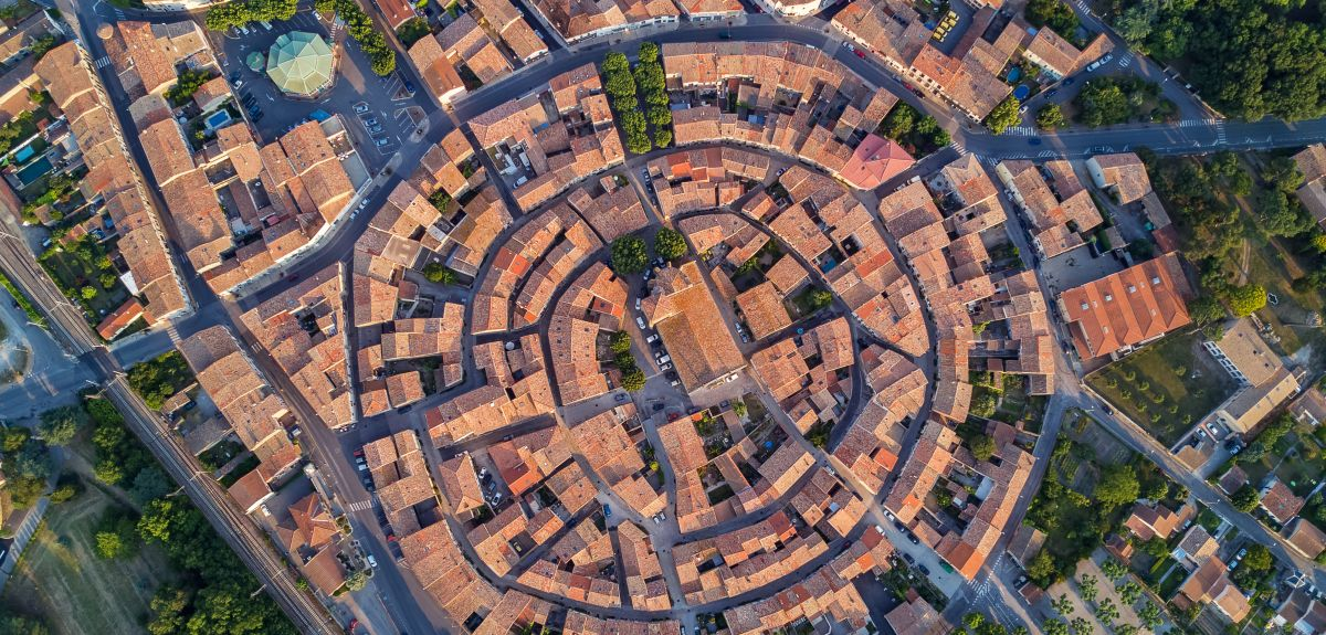 Aerial top view of Bram medieval village architecture and roofs in Southern France