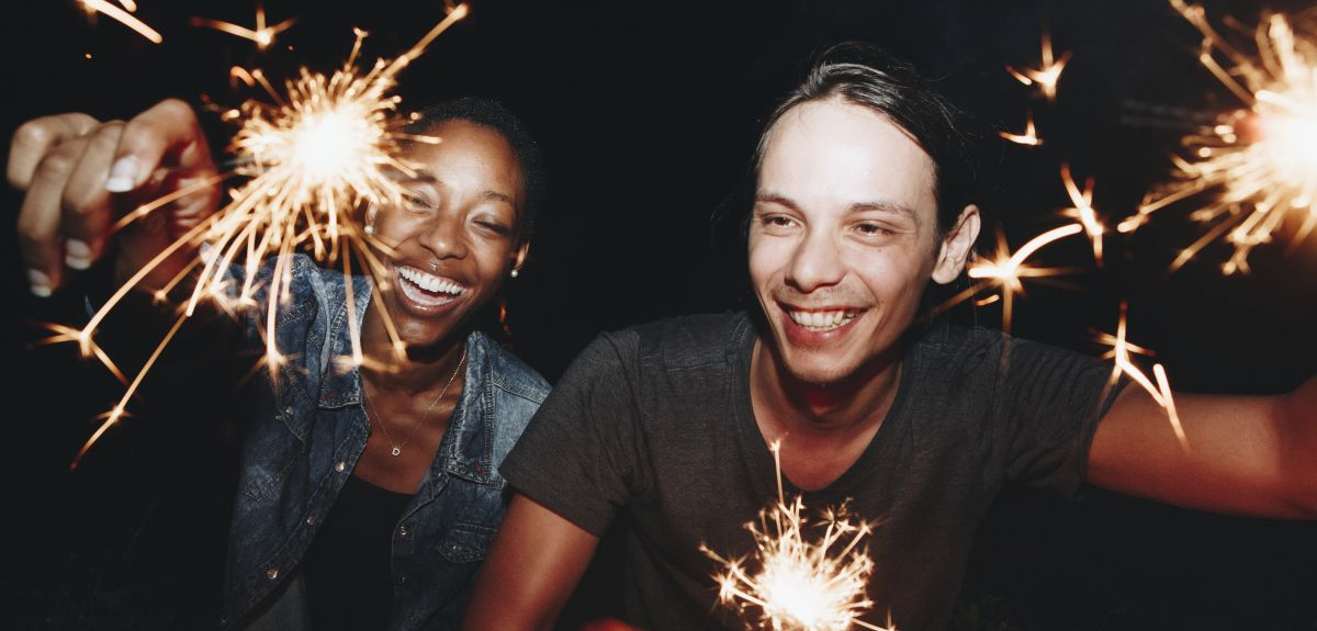 Two students holding sparklers