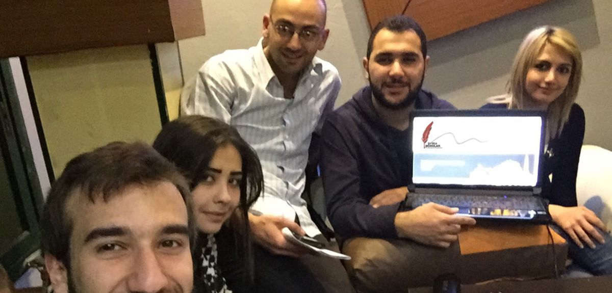 5th year Syrian medical students in an internet café in Syria receiving a tutorial on SyriaScholar.com