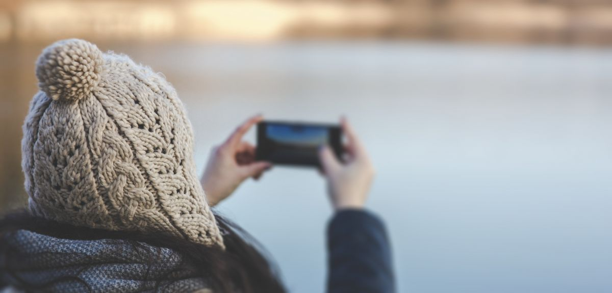 Woman taking a photo with a camera phone