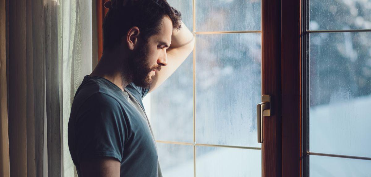 Photo | Man standing in window
