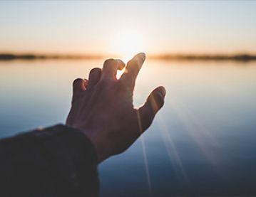 hand and sunrise
