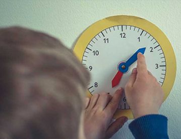 Child with toy clock