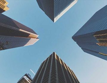 Looking up at tall buildings