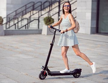 woman on e-scooter