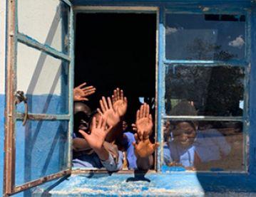 African schoolchildren waving