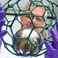 Spin-out Designer Carbon Materials: Kyriakos Porfyrakis holds a 'bucky-ball' model
