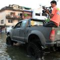 TV crew films flooding in Thailand. Image credit: Sam DCruz / Shutterstock.com