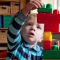 Boy stacks building blocks