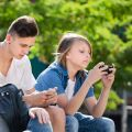 Teenagers using their smartphones