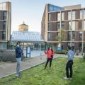 Three students socially distancing outside. Credits: John Cairns
