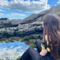 Image of a girl by a rock pool
