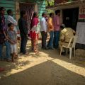 People waiting in line at polling booth