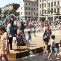People in fountain in Nottingham, UK