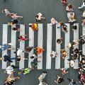 Photo | Aerial. People crowd on pedestrian crosswalk. Top view background.