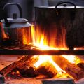 Pot and kettle on a fire for cooking