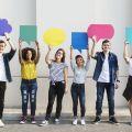 Six students holding speech bubbles
